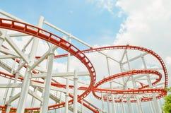 Colorful roller coaster over sky Stock Photos