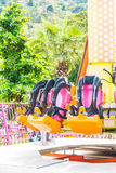 Colorful roller coaster seats at amusement park Royalty Free Stock Image