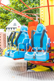 Colorful roller coaster seats at amusement park Royalty Free Stock Photography
