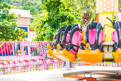 Colorful roller coaster seats at amusement park Stock Photo