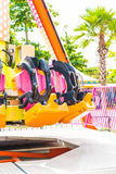 Colorful roller coaster seats at amusement park Royalty Free Stock Images