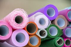 Colorful, colorful rolls of packaging material. royalty free stock photos