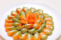 Colorful rolls on the plate Stock Images