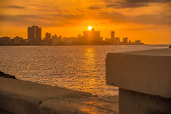 Colorful romantic sunset in Havana. Beautiful colorful sunset in Havana with a view of the Malecon seawall and the city skyline Stock Photos