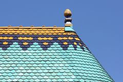 Colorful roof detail against blue sky. Colorful roof detail of an old building against blue sky - Budapest, Hungary, Europe stock image