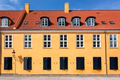 Colorful roof and facade of old building in traditional style in Copenhagen, Denmark. Historical town background.  royalty free stock photography