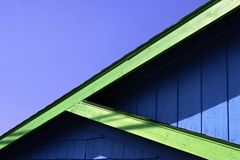 Colorful Roof Lines Against Blue Sky. Beach town roof lines Stock Photo