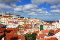 Rooftops of Alfama, Lisbon, Portugal. Colorful rooftops and houses in Alfama, Lisbon, Portugal under a scattered cloudy sky Royalty Free Stock Images