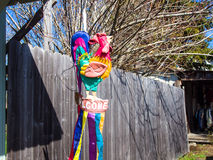 Colorful Rooster. Colorful Artificial Rooster on a Fence in a Small Town Stock Photography