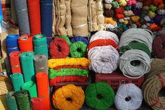 Colorful rope, cord, twine and burlap for sale in Asian market. Colorful rope, cord, twine and burlap for for sale in Asian market. The vendor`s wares spill out stock photo