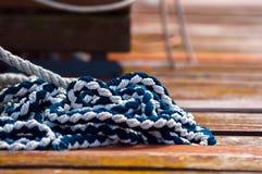 Colorful rope on sailing boat. Closeup photo Stock Image