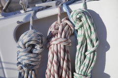 Colorful ropes hanging on yacht railings Stock Image