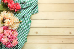Colorful rose and cloth on wooden background. Royalty Free Stock Photos