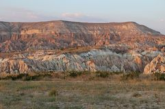 Colorful Rose valley mountain at sunset in Cappadocia, Red canyon in Goreme village, Turkey. Popular tourist destination in Turkey for trekking Stock Image
