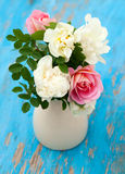 Colorful roses on blue wooden background Royalty Free Stock Photo
