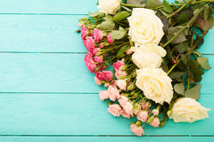 Colorful roses on blue wooden background Royalty Free Stock Image