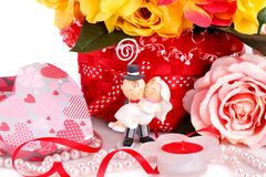 Wedding day. Colorful roses, bride and fiance, candle and gift box close up picture Royalty Free Stock Images