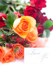 Colorful roses and a card with the words thank you Royalty Free Stock Photos