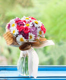 Colorful roses and daisies bouquet at the window Royalty Free Stock Photography