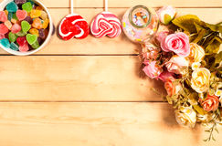 Colorful roses flowers with sweet Jelly, flavor fruit, candy hea Stock Photos