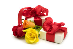 Colorful roses and gift box Stock Image