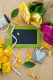 Colorful roses and a little blackboard Royalty Free Stock Photos