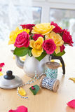 Colorful roses in a tea can Royalty Free Stock Image
