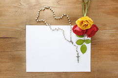 Colorful roses and white rosary on wood Royalty Free Stock Photography