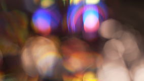 Colorful rotating bokeh visual effect motion background. This 4k macro shot of a rotating collection of stained glass is perfect as a motion background, texture stock video