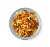 Colorful Rotini corkscrew pasta with vegetables on plate Stock Images