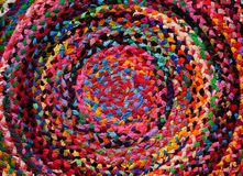 Colorful round african peruvian style rug or woven carpet surface close up. Ethnic and tribal motives. Bright accent in. Interior or home decoration royalty free stock photography