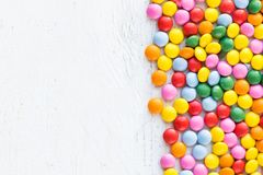 Colorful round candies on white rustic wooden background  with c Royalty Free Stock Photography