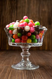 Colorful round-candy in a glass vase Stock Image