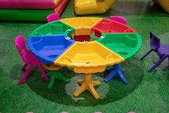 Colorful round plastic table with sand pit and chair on pattern royalty free stock photos