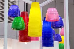 Colorful round stylish lampshades hang from ceiling Stock Photo