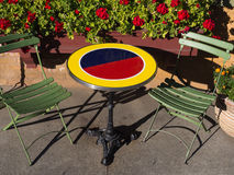 Colorful round table with two chairs Stock Images