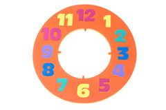 Colorful and round toy circle clock isolated in white background Royalty Free Stock Photo