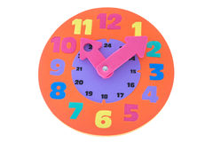 Colorful and round toy clock isolated in white background with c Royalty Free Stock Image