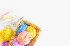 Colorful round yarn mat. Crochet. Yarn in coils and tangles. Whi. Crocheted home bright colored mat. Rainbow yarn in the basket. Hooks for knitting Royalty Free Stock Image