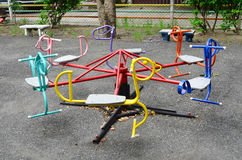 Colorful roundabout for children at public playground Stock Photography