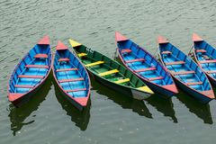 Colorful row boats docked on Lake Phewa in Pokhara royalty free stock photo