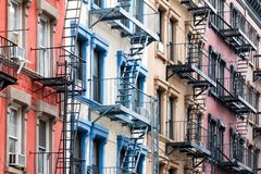 Colorful row of buildings in Greenwich Village New York City NYC. Colorful row of historic buildings in the Greenwich Village neighborhood of Manhattan in New Royalty Free Stock Image