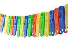 Colorful row of clothes pegs Stock Images