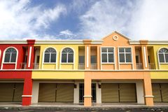 Colorful row houses. Row of new houses in vibrant colors Royalty Free Stock Photos