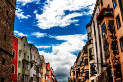 Colorful row of houses close to the city tower in Innsbruck, Austria Royalty Free Stock Photography