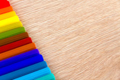 Colorful row of markers on wooden table Royalty Free Stock Photo