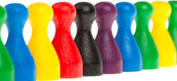 Colorful row of pawns Stock Images