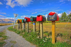 Colorful row of post boxes Stock Images