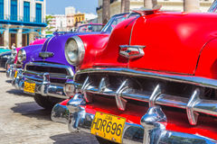 Colorful row of vintage american cars. On June 21, 2013 in Havana.These classic cars are a worldwide famous sight and a tourist attraction of the island Royalty Free Stock Image