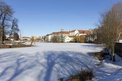 Colorful royal snowy medieval Town Pisek above the frozen river Otava, Czech Republic Stock Photography
